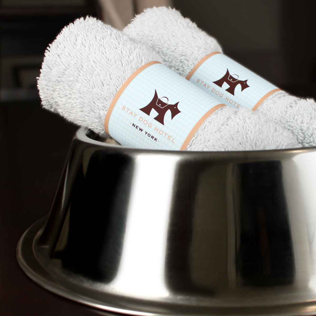 Branded towels in dog bowl