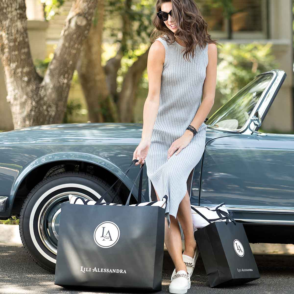 woman with Lili Alessandra bags