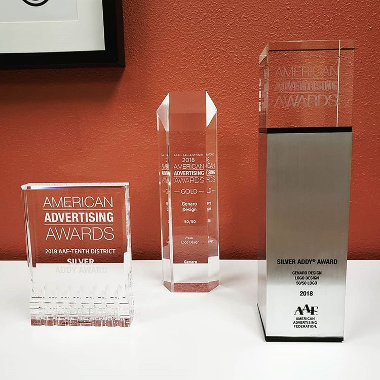 photo of three recent American Advertising Awards