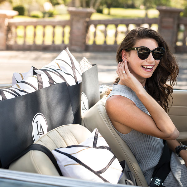 Woman in car with Lili Alessandra bags